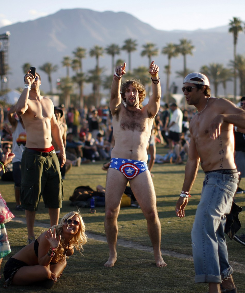 People dance at the 2012 Coachella Valley Music and Arts Festival in Indio, California.