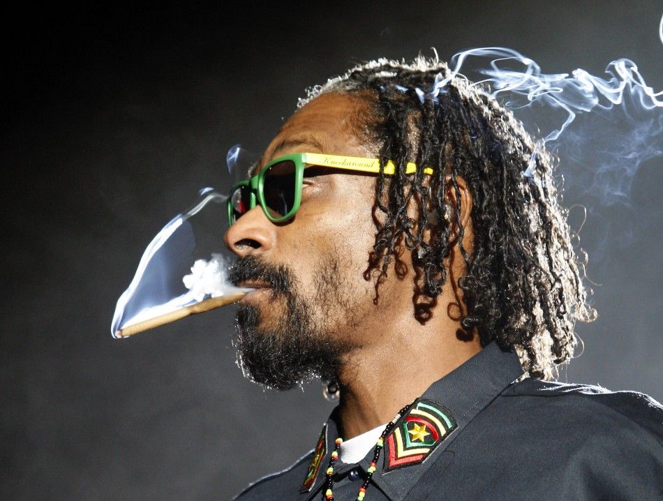 Snoop Dogg smokes while performing at the 2012 Coachella Valley Music and Arts Festival in Indio, California.