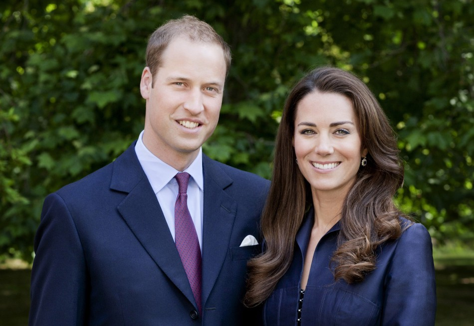 Britains Prince William and Catherine, Duchess of Cambridge pose for the official tour portrait for their trip to Canada and California, in the gardens of Clarence House in London