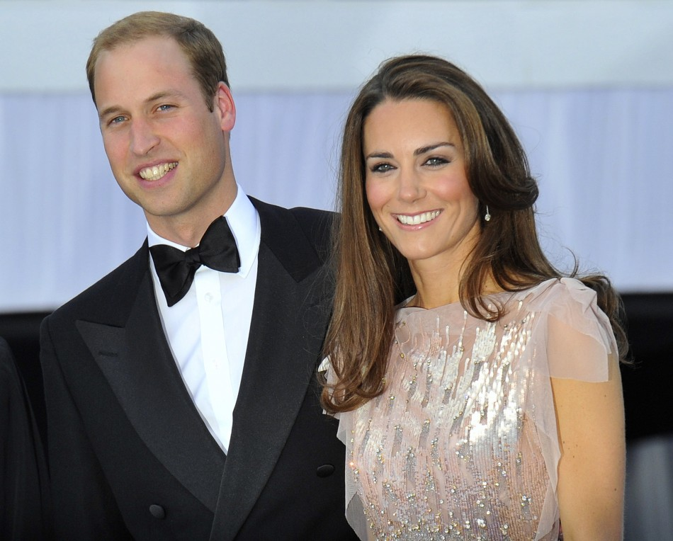 Britains Prince William and his wife Catherine, Duchess of Cambridge arrive for a charity dinner at Kensington Palace in London