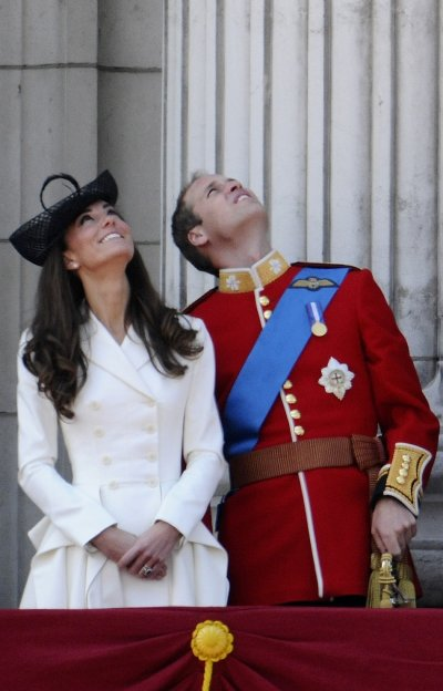 Britains Prince William and his wife Catherine, Duchess of Cambridge, watch a fly-past from the balcony of Buckingham Palace after attending the Trooping the Colour ceremony in central London