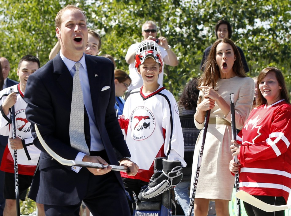 Britains Prince William and his wife Catherine, the Duchess of Cambridge, react during visit to Somba Ke Civic Plaza in Yellowknife
