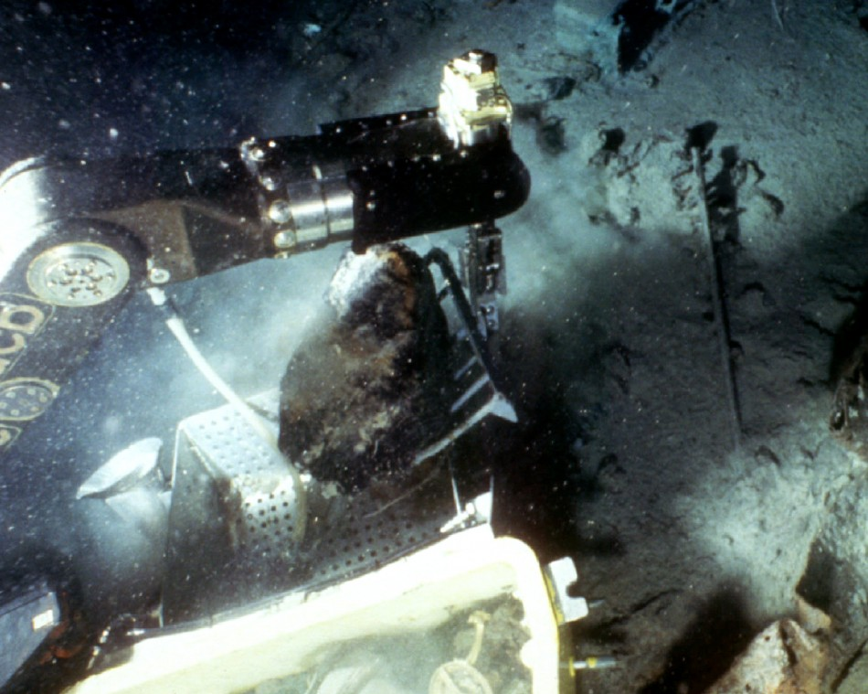 A remote-controlled robot recovers a piece of coal from the sunken luxury liner the Titanic
