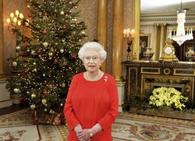 Queen Elizabeth II stands in the 1844 Room of Buckingham Palace in London