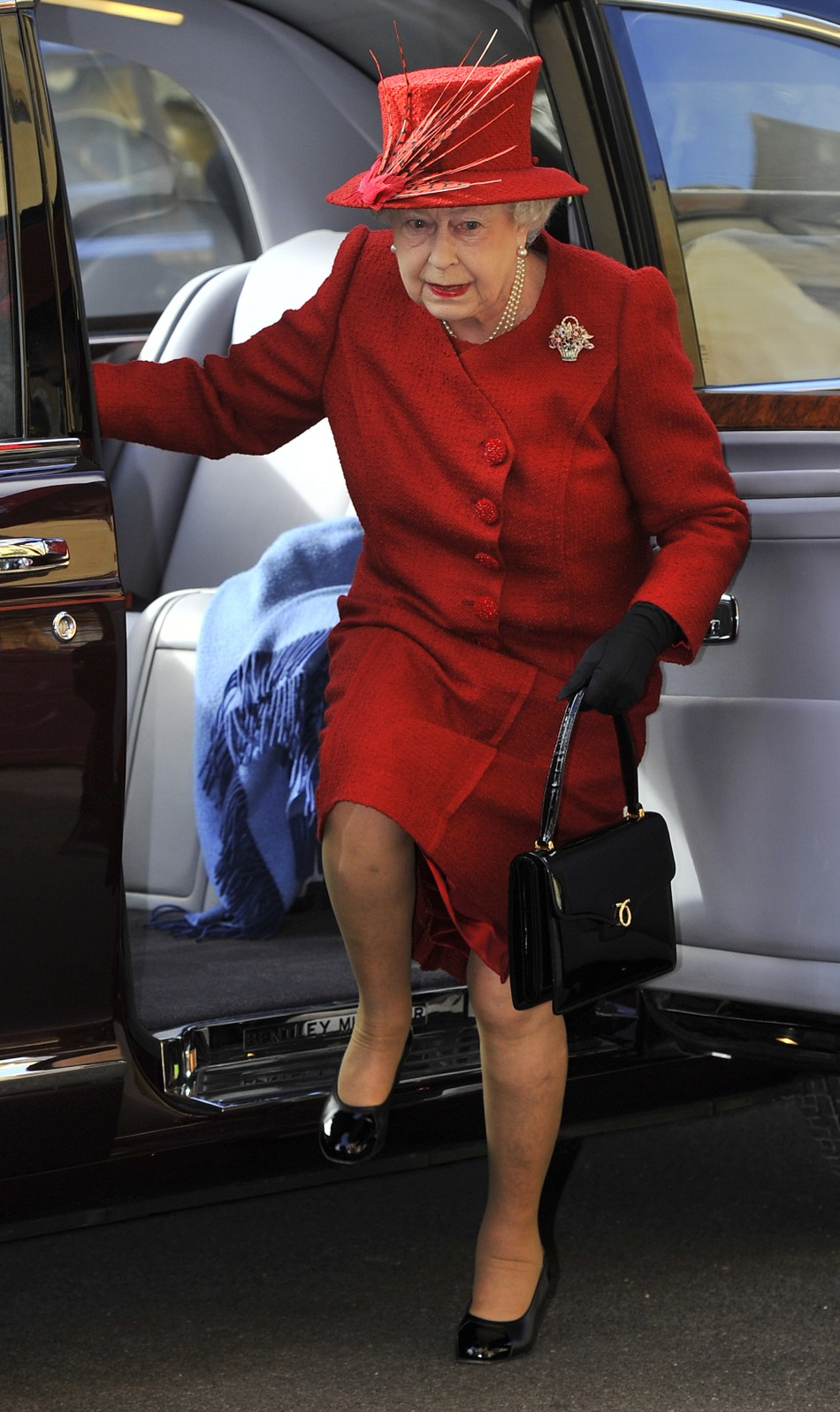 Britain's Queen Elizabeth II leaves St George's Chapel in Windsor Castle after attending an Easter Matins Service, in Windsor, England