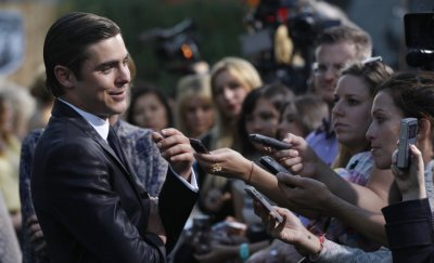 Cast member Zac Efron drops a condom from his pocket when he poses at the premiere of quotThe Lucky Onequot at the Graumans Chinese theatre in Hollywood, California April 16, 2012.