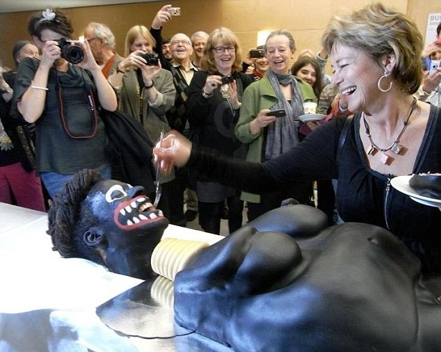 Culture Minister Lena Adelsohn Liljeroth cut the 'racist' cake at an art event (Facebook)