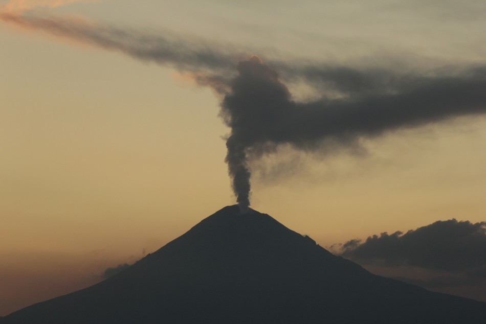 The Popocatepetl volcano spews a cloud of ash and steam high into the air (Reuters)