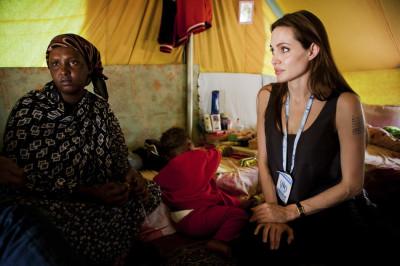 Handout shows UNHCR Goodwill Ambassador Jolie visiting Somali refugees at Shousha Camp, near the Tunis-Libyan border, at Ras Djir