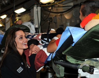 Angelina Jolie meets with wounded U.S. Service members preparing to travel back to the U.S. during a visit to Ramstein Air Base Germany