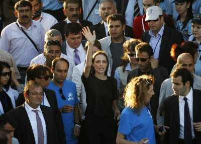 United Nations High Commissioner for Refugees UNHCR Goodwill Ambassador Angelina Jolie greets media members as she leaves from Hatay airport