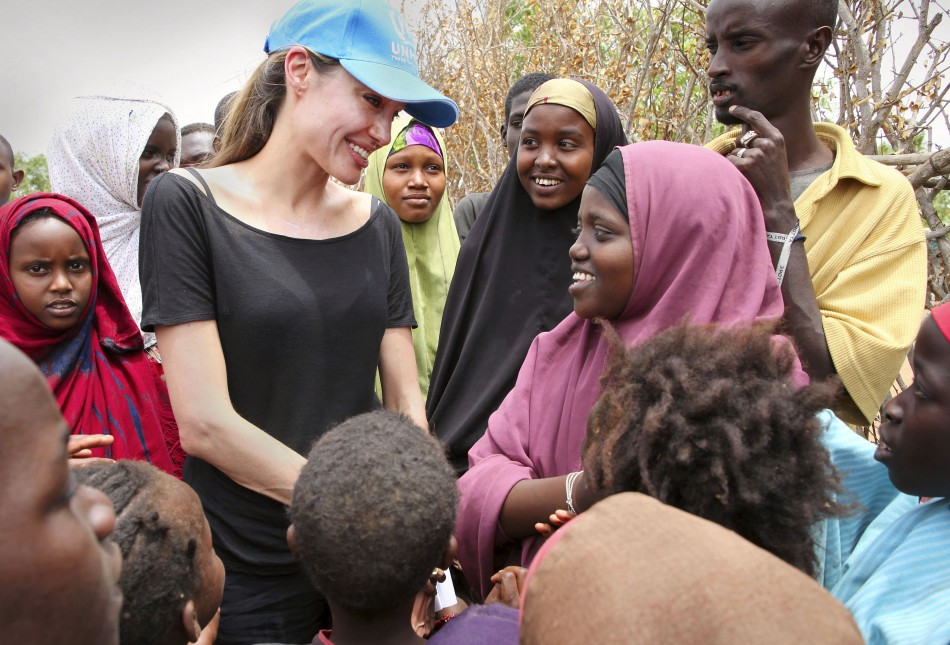 UNHCR Goodwill Ambassador and actress Jolie chats with children in the Dadaab refugee camp on the Kenya-Somali border