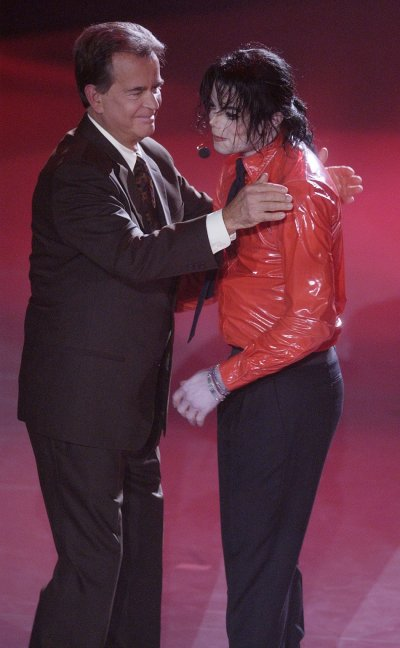 Singer Michael Jackson R is thanked by Dick Clark, host of quotAmerican Bandstands 50th...A Celebrationquot after performing quotDangerousquot for the show in Pasadena, California, April 20, 2002.