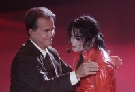 "Singer Michael Jackson (R) is thanked by Dick Clark, host of ""American Bandstand's 50th...A Celebration"" after performing ""Dangerous"" for the show in Pasadena, California, April 20, 2002."