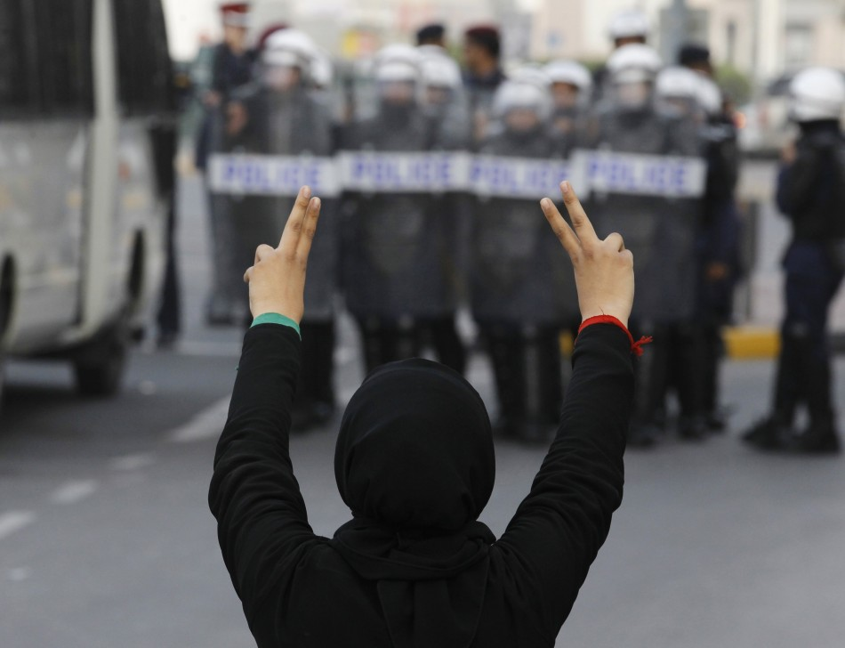 A protester flashes a victory sign during an anti-government rally in Manama
