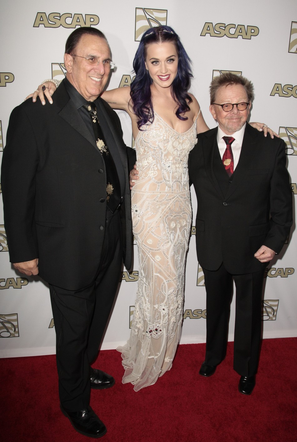 Singer-songwriter Katy Perry, ASCAP CEO John LoFrumento and ASCAP President Paul Williams arrive at the 29th Annual ASCAP Pop Music Awards in Hollywood, California