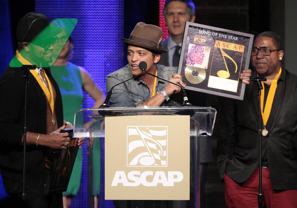 "Singer-songwriter Mars accepts the award for Song of the Year for ""Just the Way You Are"" with co-writers Kalb and Lawrence at the ASCAP Pop Music Awards in Hollywood"