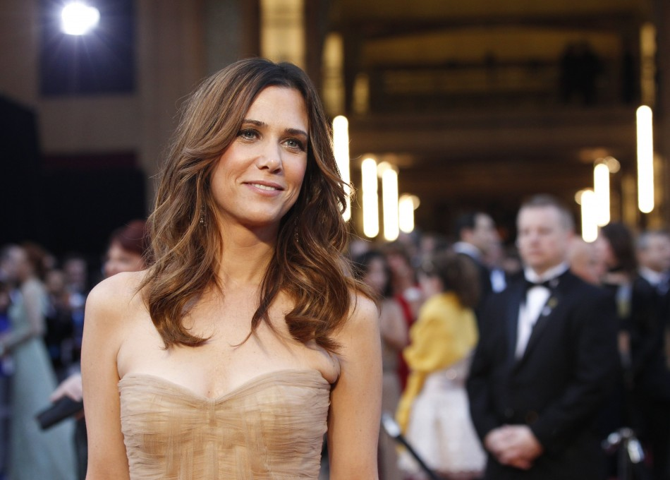 """Wiig, best original screenplay nominee for the film """"Bridesmaids,"""" poses at the 84th Academy Awards in Hollywood"""