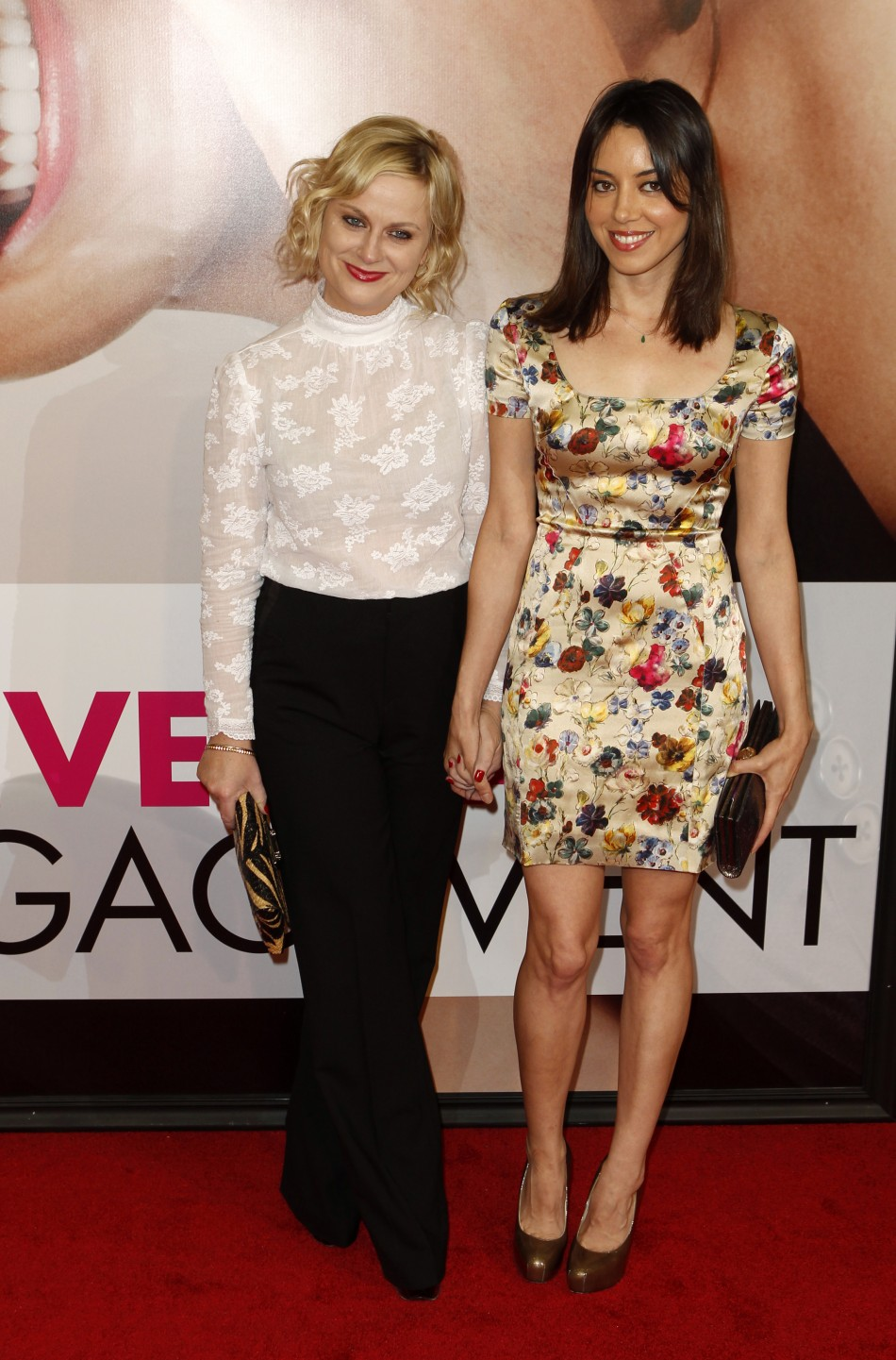 "Actress Amy Poehler arrives with Aubrey Plaza for the premiere of the film ""The Five-Year Engagement"" to begin the 2012 Tribeca Film Festival in New York"
