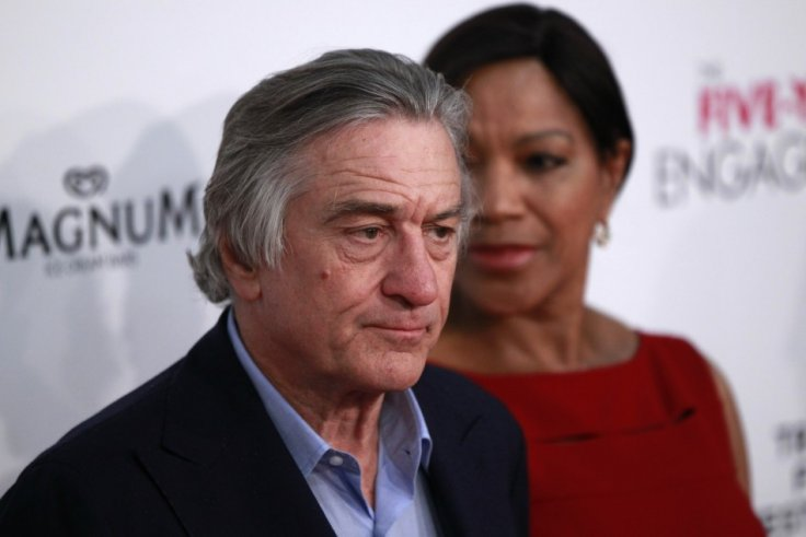 """Actor Robert DeNiro arrives with Grace Hightower for the premiere of the film """"The Five-Year Engagement"""" to begin the 2012 Tribeca Film Festival in New York"""