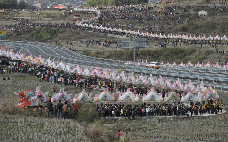"Villagers perform the annual ""dragon march"" to celebrate the Lantern Festival in Gutian township"
