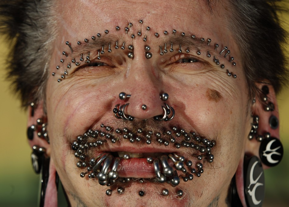 Guinness World Record holder for the Most Pierced Man Bucholz shows some of his 453 piercings in Dortmund