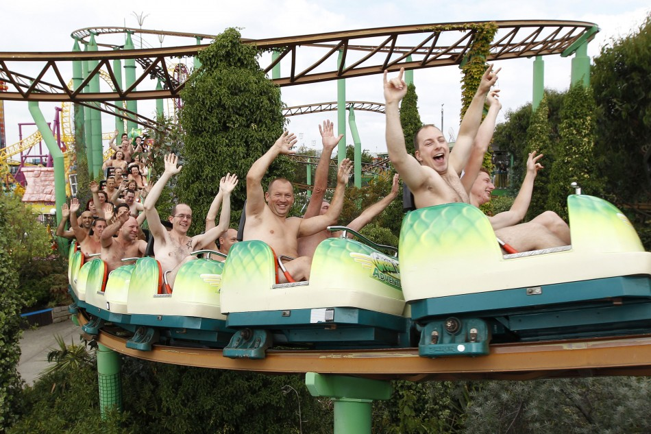 Thrillseekers take part in a world record-breaking nude rollercoaster ride, to raise money for Southend Hospital's breast care unit, at an amusement park in Southend-on-Sea