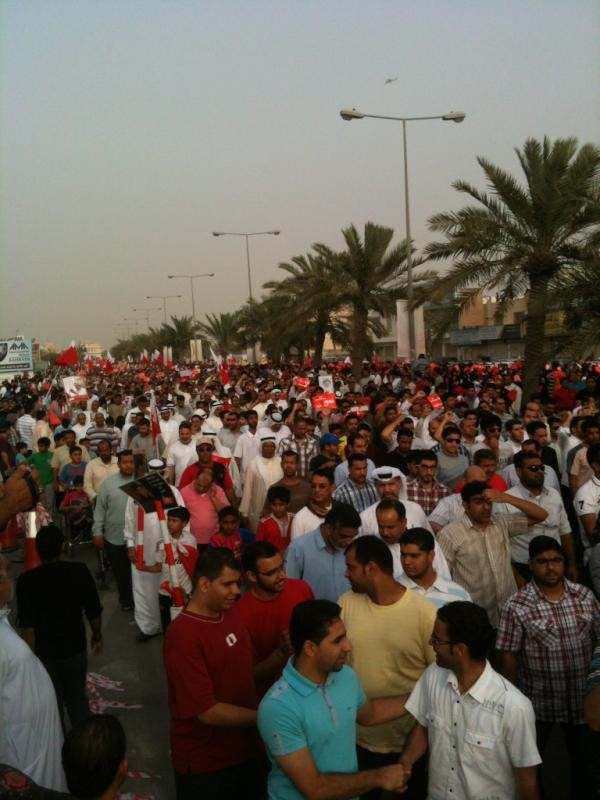 Protesters march towards the Formula One Grand Prix circuit in Bahrain