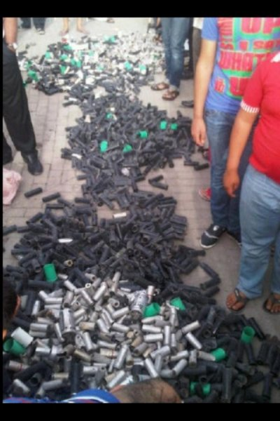Protesters gathered the tear gas canisters they say were used by security forces