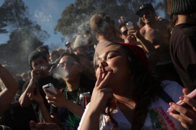 People smoke marijuana joints at 420 p.m. as thousands of marijuana advocates gathered at Golden Gate Park in San Francisco