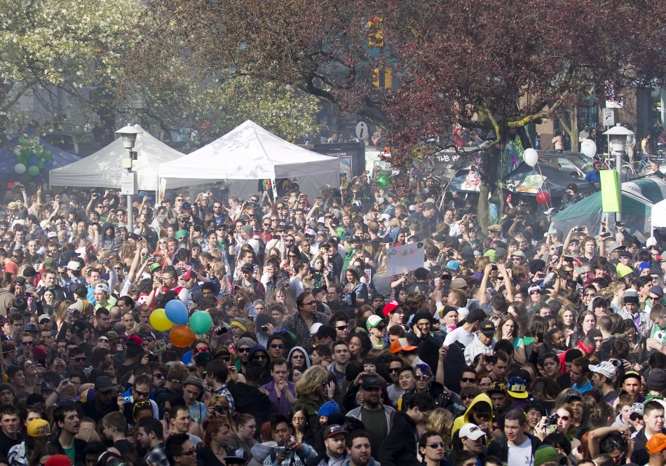 A smoke cloud is seen over the crowd at the Vancouver Art Gallery
