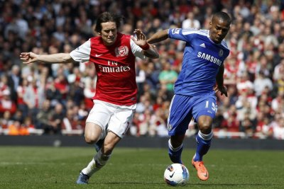 Arsenal039s Rosicky challenges Chelsea039s Malouda during the English Premier League soccer match at the Emirates Stadium in London