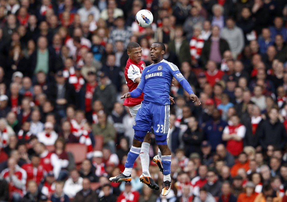 Arsenal039s Gibbs challenges Chelsea039s Sturridge during the English Premier League soccer match at the Emirates Stadium in London