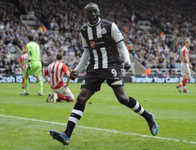 Newcastle United039s Cisse celebrates scoring against Stoke City during their English Premier League soccer match in Newcastle