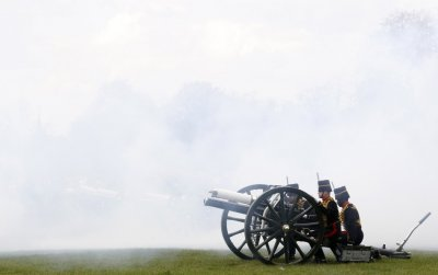 Gunners from The King039s Troop Royal Horse Artillery prepare to fire a round during a forty-one gun salute in London