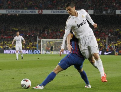 Real Madrid039s Cristiano Ronaldo tries to get past Barcelona039s Puyol during their Spanish first division soccer match in Barcelona