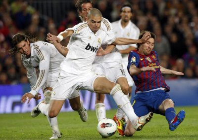 Barcelona039s Messi is challenged by Real Madrid039s Pepe, Coentrao and Ramos during their Spanish first division quotEl Clasicoquot soccer match in Barcelona