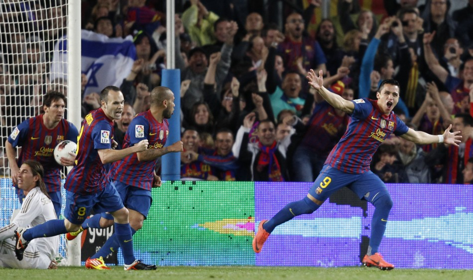 Barcelona039s Alexis celebrates after scoring against Real Madrid during their Spanish first division soccer match against Real Madrid in Barcelona