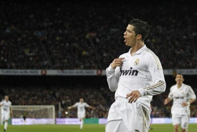 Real Madrid039s Cristiano Ronaldo celebrates after scoring against Barcelona during their Spanish first division soccer match in Barcelona