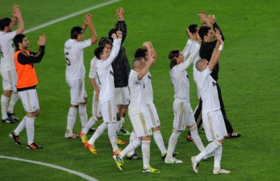 Real Madrids players celebrate victory over Barcelona at the end of their Spanish first division quotEl Clasicoquot soccer match