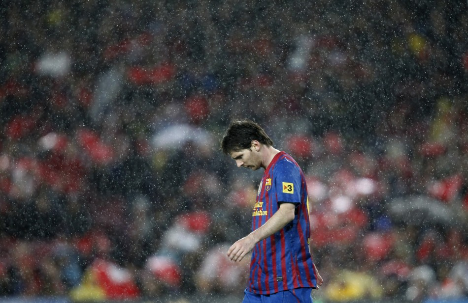 Barcelona039s Messi walks off the pitch at the end of their Spanish first division soccer match against Real Madrid in Barcelona