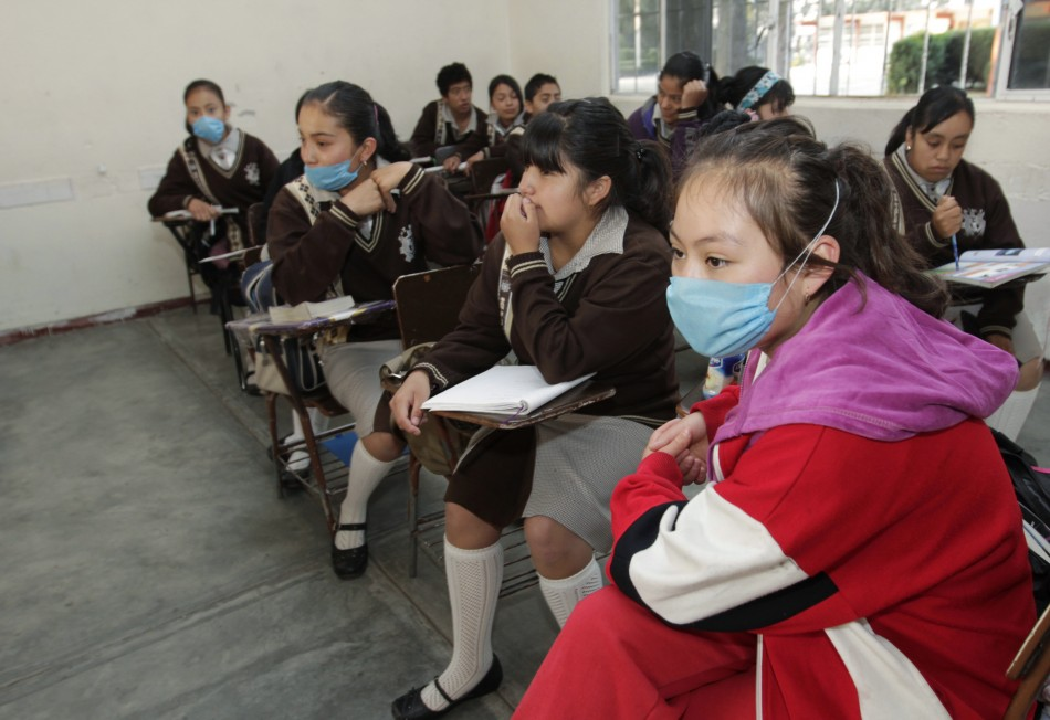Some students wearing surgical masks