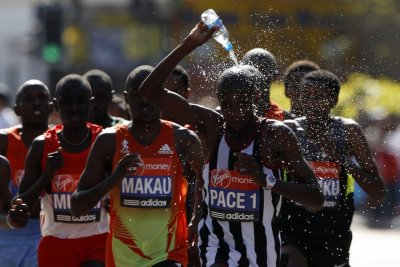 A runner cools himself with water during the men039s London Marathon