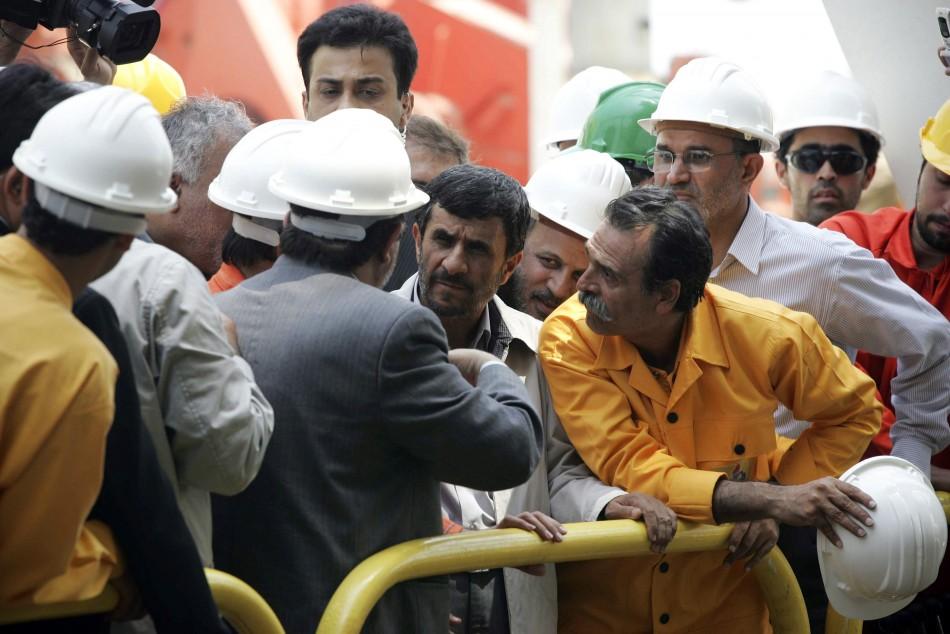 Iranian President Mahmoud Ahmadinejad listens to Seifollah Jashnaz, managing director of National Iranian Oil Company