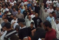 Hundred of mourners gather in village of Bilad Alqadem for funeral of Salah Abbas Habib, whose body was found on rooftop of village following his arrest by riot police in Bahrain