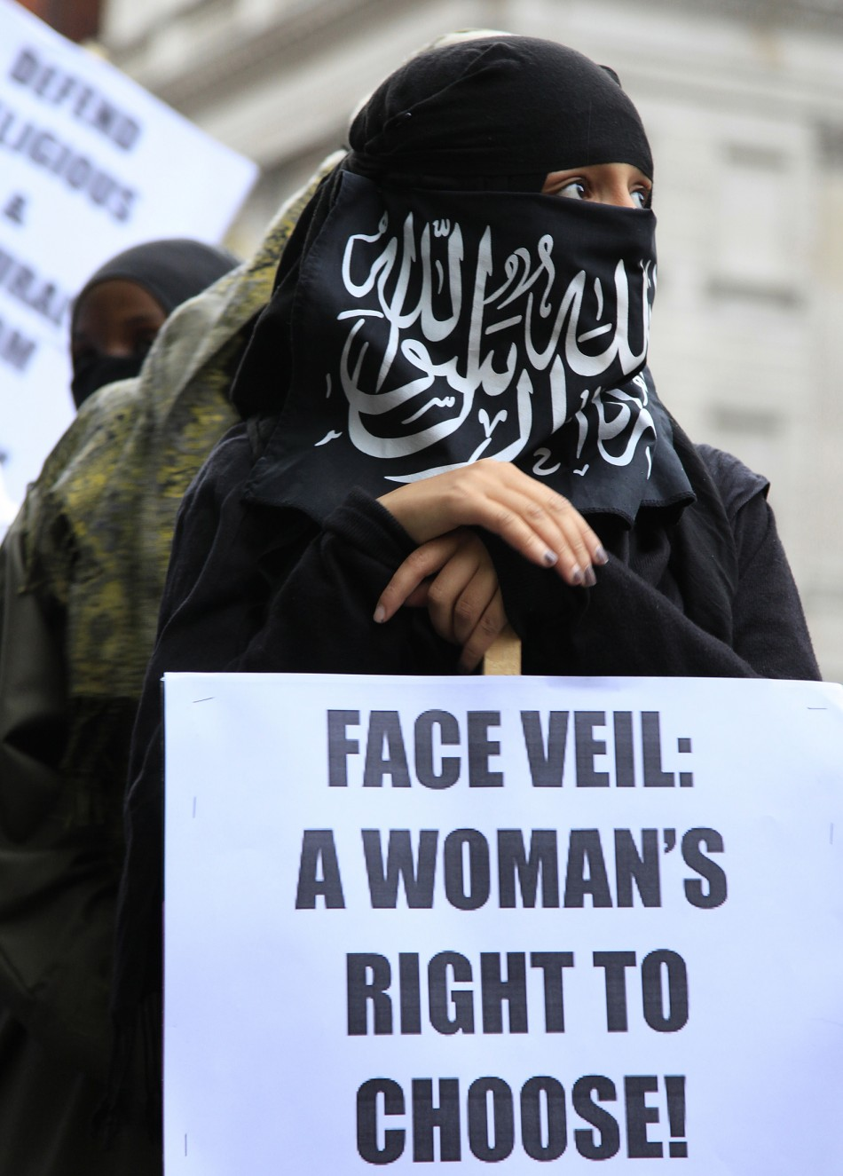 A demonstrator holds a placard during a protest outside the French embassy in London