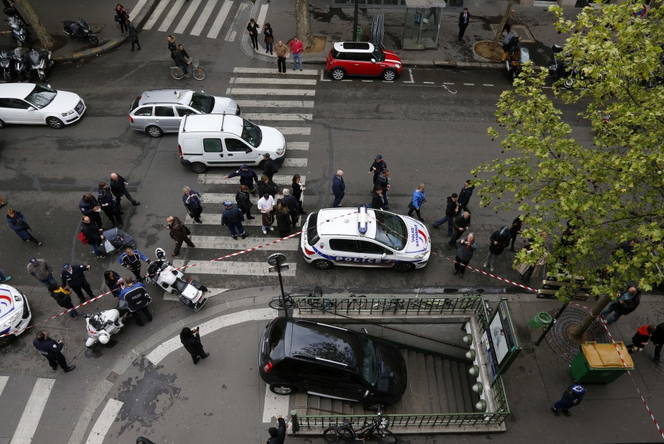 French police gather at the entrance to the Chaussee dAntin La Fayette