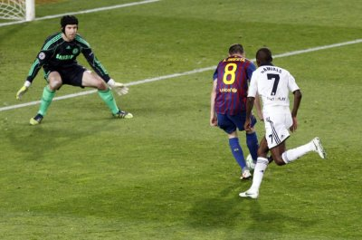 Barcelona039s Iniesta scores a goal past Chelsea039s Cech and Ramires during their Champions League soccer semi-final in Barcelona