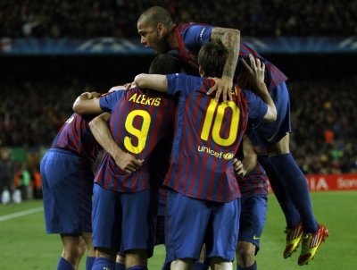 Barcelona039s Dani Alves jumps over team mates as they celebrate a goal against Chelsea during their Champions League soccer semi-final in Barcelona