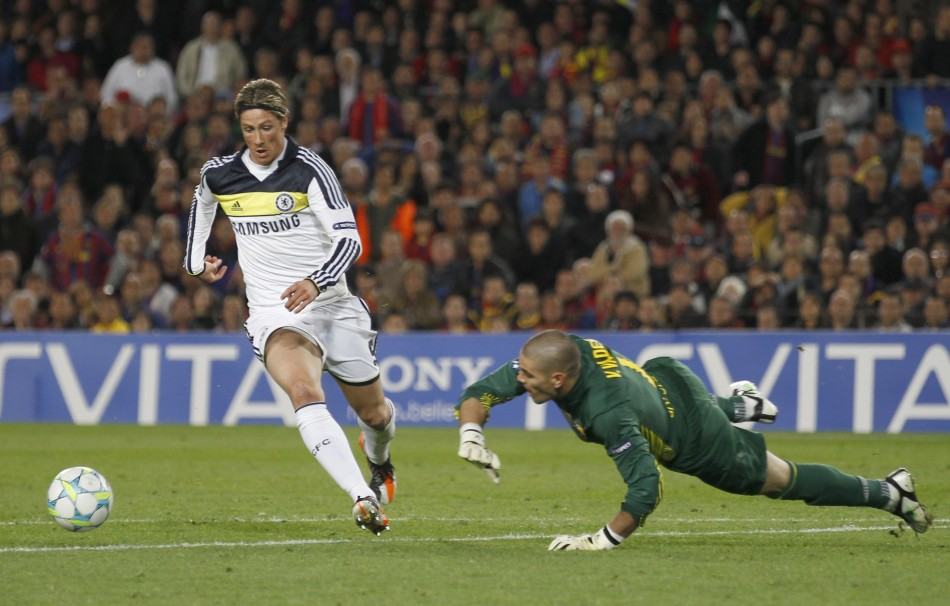 Chelsea039s Fernando Torres shoots to score past Barcelona039s goalkeeper Victor Valdes during their Champions League semi-final second leg soccer match at Camp Nou stadium in Barcelona